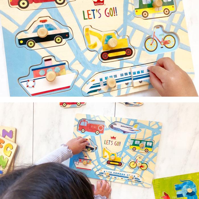 乗り物パズルで遊ぶ子供